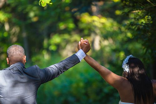 photo couple holding each other's hands free for commercial use images