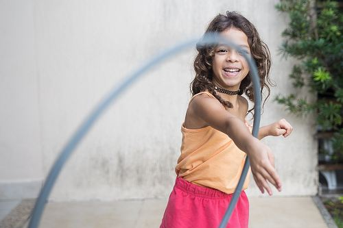 photo girl playing hula hoop on his arm free for commercial use images