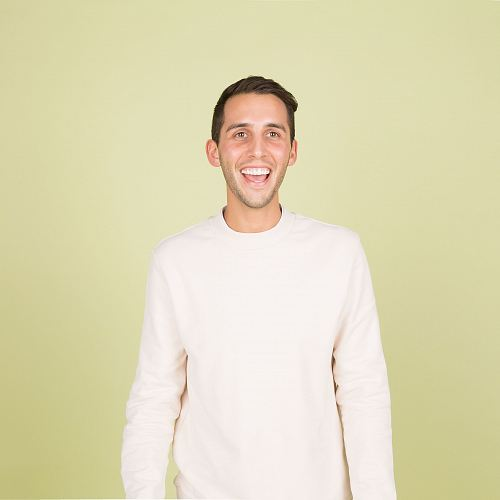 photo man wearing white crew-neck long-sleeved shirt standing inside well lighted room free for commercial use images