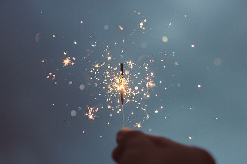 photo person holding lighted sparklers free for commercial use images