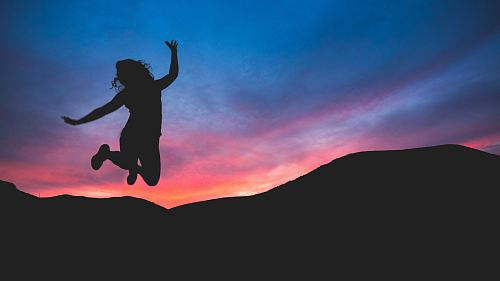 photo silhouette of person jumping during dawn free for commercial use images