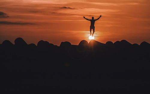 photo silhouette of person jumping in mid air free for commercial use images