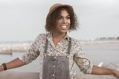 woman in gray overalls