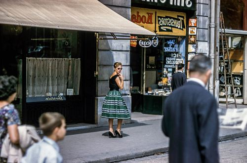 photo woman looking left while standing beside store along the road free for commercial use images