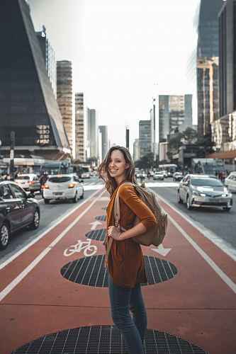 photo woman standing on middle of road free for commercial use images