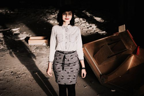 photo woman wearing gray long-sleeved shirt and gray skirt standing free for commercial use images