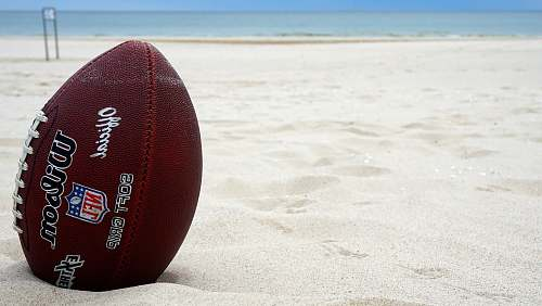 sports brown Wilson football on sand sport