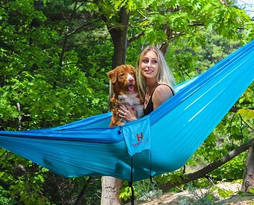 hammock woman and dog on blue hammock flora