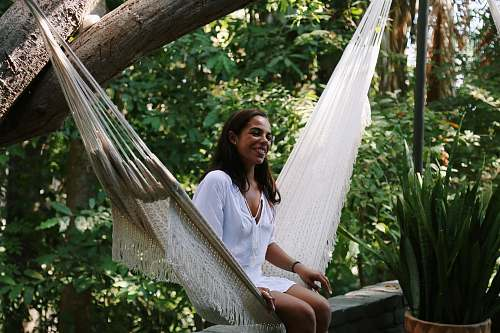 human woman sitting on hammock person