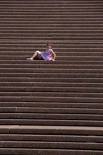person girl in purple dress sitting on stairs apparel