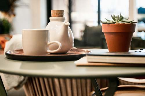 drink white cup beside teapot on tray beverage