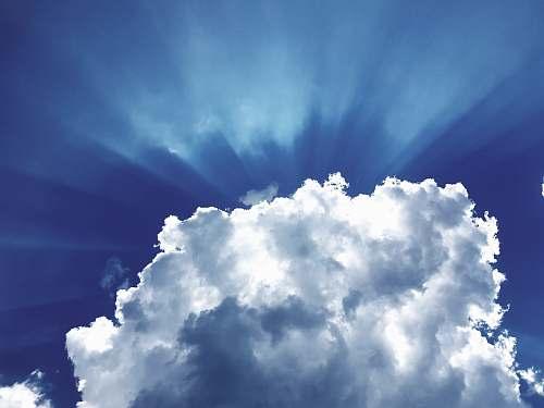 sky sun rays through white cumulus clouds cloud