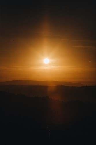 sun silhouette photo of sunset sky