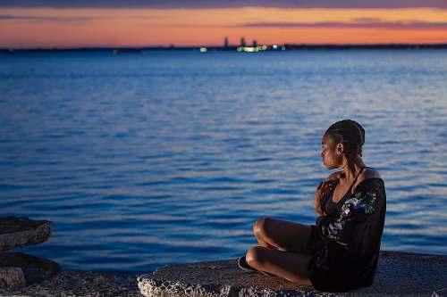 human woman sitting near sea people