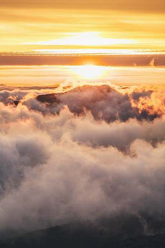 cloud mountain covered in clouds during golden hour nature