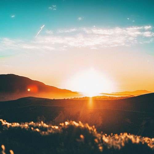 sunrise sunset over the horizon sky