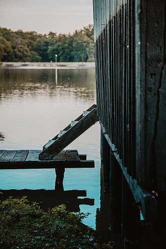 waterfront gray wooden dock beside body of water close-up photography dock
