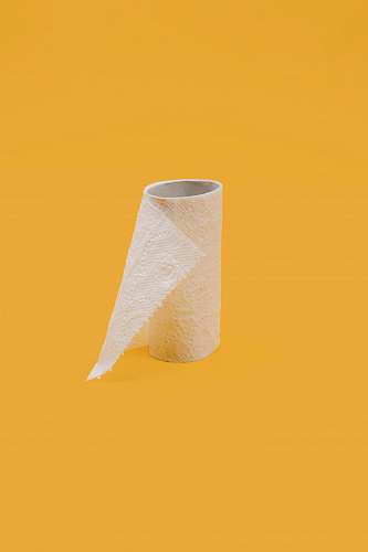 pandemic white tissue paper roll on yellow surface quarantine