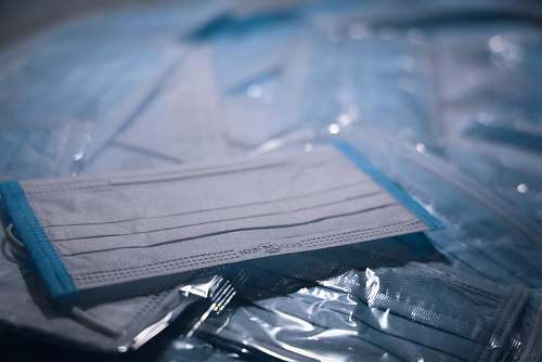 grey blue textile on clear plastic pack facemask