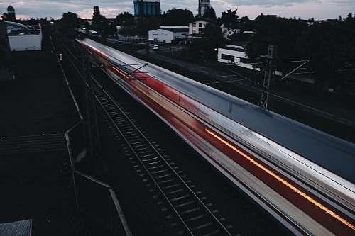 transportation time lapse photography of train vehicle