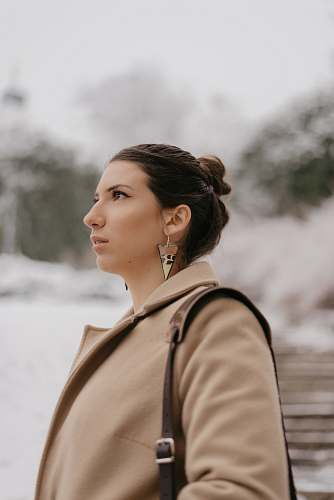 selective focus photography of woman in brown coat