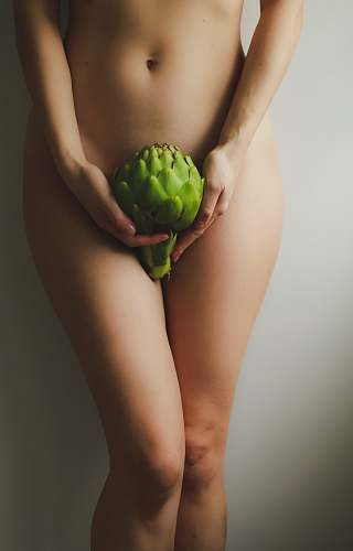 food naked woman holding green fruit produce