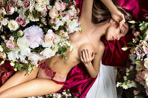 blossom woman in red tube dress holding white and pink flowers flower arrangement