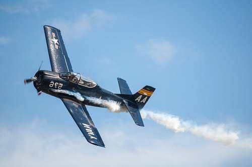 airplane black biplane doing aerobatics transportation