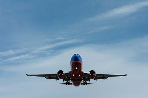 photo transportation blue and red airplane on sky aircraft free for commercial use images