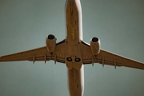 plane low angle photography of white airliner sky