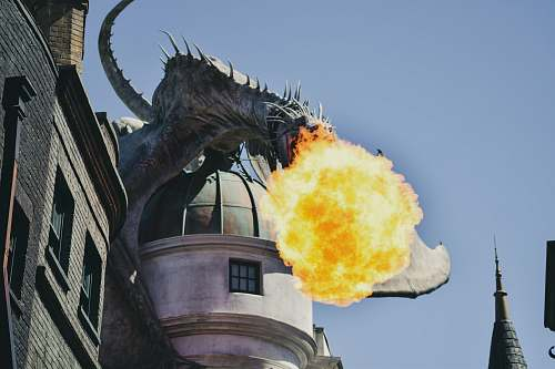 building fire breathing dragon figure on building rooftop orlando