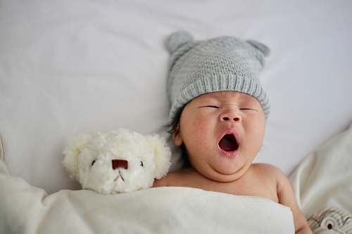 human baby's gray knit hat person