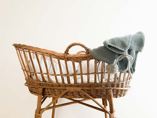 photo cradle gray textile hanging on brown wicker basket furniture free for commercial use images