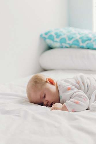 newborn photo of baby laying on bed kid