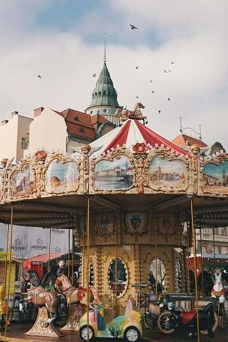 building carousel ride under bright sky amusement park