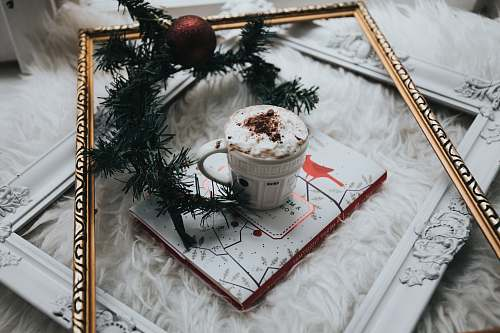 winter white ceramic mug filled with whit mousse food