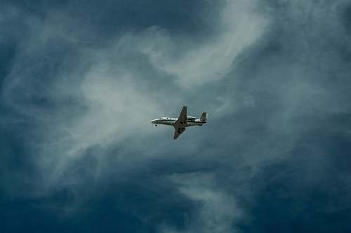 grey airliner on sky photography sky