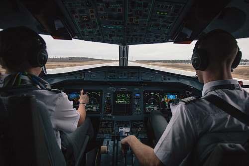 people two men driving plane at daytime human