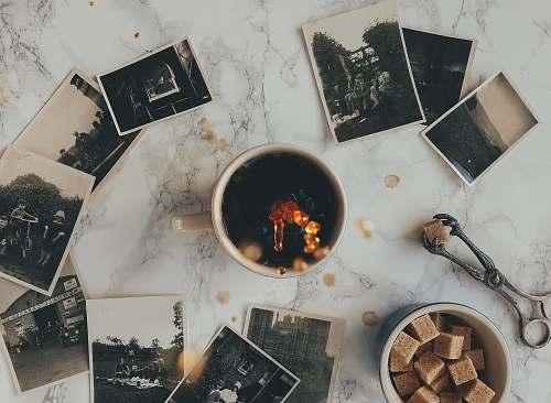 photos assorted grayscale photos near white ceramic mug sugar