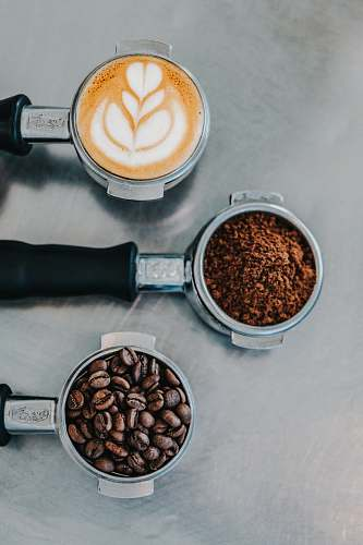 food flat lay photography of coffee latte, ground coffee, and coffee beans vegetable