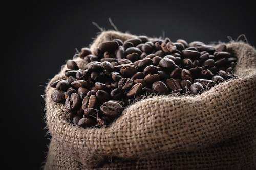 bean shallow focus photography of coffee beans in sack food