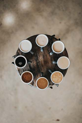 photo coffee flat lay photography of eight coffee latte in mugs on round table drink free for commercial use images