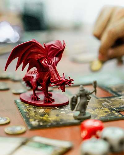human red dragon action figure on table person