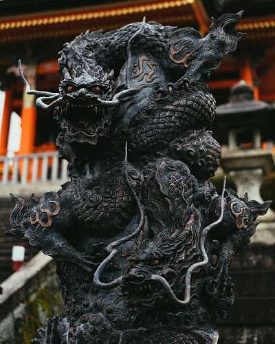 photo temple shallow focus black concrete dragon statue architecture free for commercial use images
