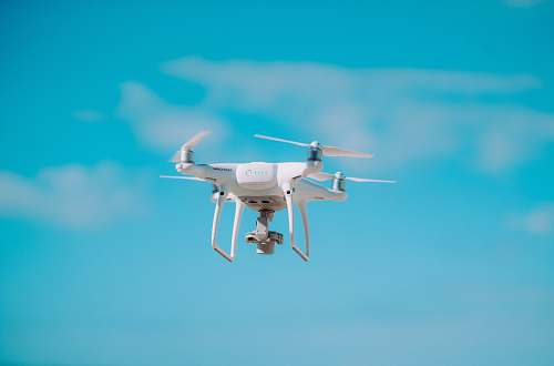 photo fly white quadcopter flying during daytime flight free for commercial use images