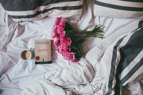 book bouquet of pink flowers on top of bed flower