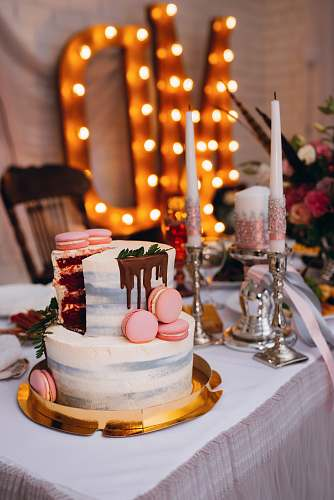cake 2-tier cake on table beside candles dessert