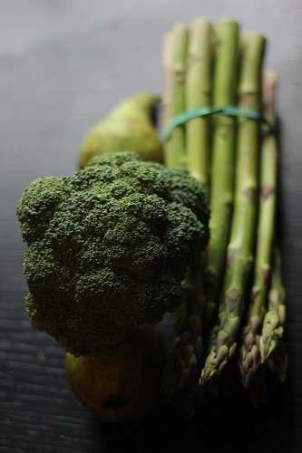 plant broccoli and asparagus on a table broccoli