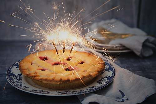 pie brown pie with sparklers on top dessert
