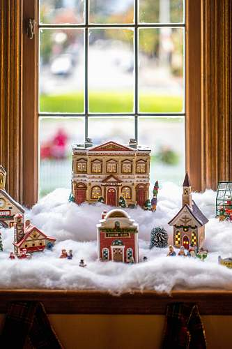 biscuit ceramic Christmas village displayed by the window cookie